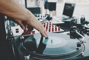 Outdoor music party. Dj playing on vinyl. Dj's hands and turntable close up