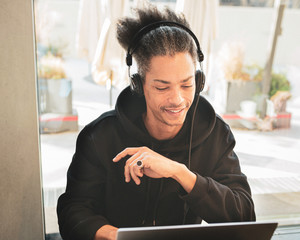 Creative afro american man, with weird hair, is studying and creating new content for his personal blog, latin american working on web project, lifestyle concept of blogger, influencer, smart working