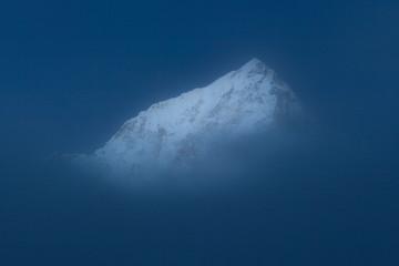 Nuptse Peak Above The Cloud in Moonlight, Nepal. Trek to Everest Base Camp.