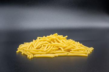 raw pasta on a black background