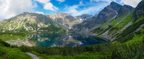 Mountain lake surrounded by craggy ridges in Tatra Mountains