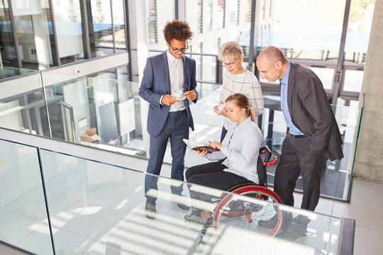 Businesswoman in a wheelchair makes appointment planning