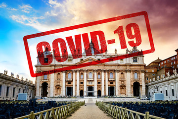 Dramatic sunset over facade of the basilica of St. Peter's in the Vatican, Rome, Italy, with sign #stayhome regarding Covid-19 pandemic.