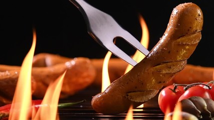 Wall Mural - Grilled sausages on the flaming grill