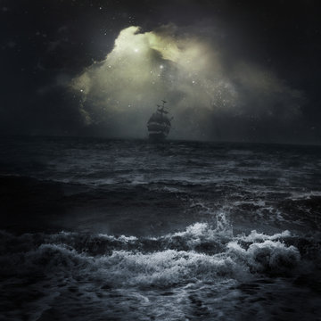 Stormy sea ship in the distance romantic scene dark sky clouds Sun rays