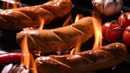 Fototapete - Grilled sausages on the flaming grill