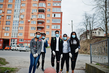 Group of african teenagers friends against empty street with building wearing medical masks protect from infections and diseases coronavirus virus quarantine.