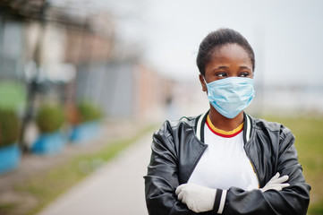 African girl at park wearing medical masks protect from infections and diseases coronavirus virus quarantine.