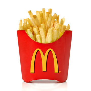 Los Angeles, California - May 17, 2019: McDonald's French Fries in paper cup isolated on checkered background. McDonald Company is the most popular market leader in USA