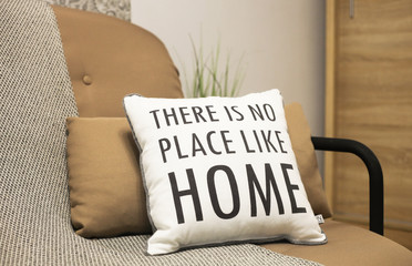 Cushions with a text There is no place like home. Stay home, work from home coronavirus prevention...