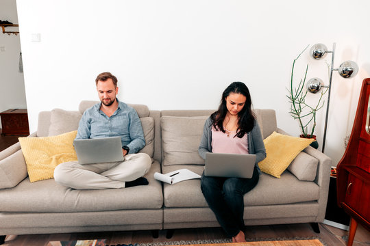 couple teleworking from home - remote work freelance or employed concept