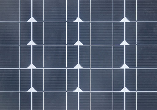Close up Monocrystalline silicon solar panels or single crystalline silicon solar cells in solar power plant station systems convert light energy from the sun into electricity