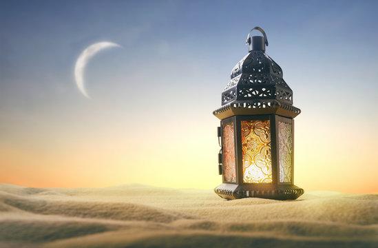 Ornamental Arabic lantern with burning candle