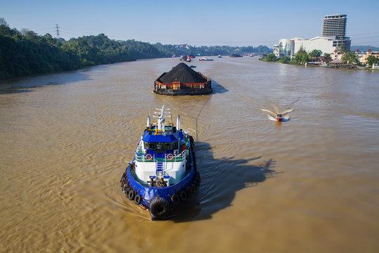 coal transported by the barges on Mahakam river, Samarinda, East Kalimantan, Indonesia
