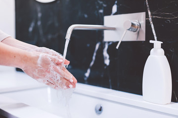 Washing hands with foam soap. Hygiene, preventing coronavirus