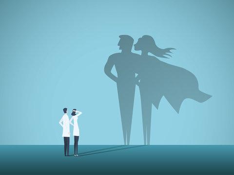 Doctors looking at superhero shadow on the wall. Hospital staff, nurses heroes fight coronavirus pandemic, epidemic.