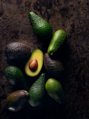 half avocado on group of avocados