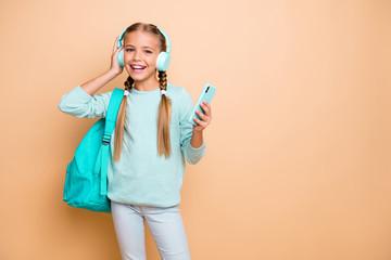 Photo of pretty funny little lady listen earphones youth modern song walk school browsing telephone...