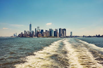 Manhattan seen from water, color toning applied, New York City, USA.