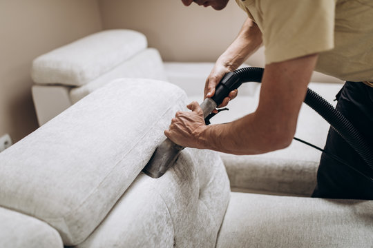 Process of deep furniture cleaning, removing dirt from sofa. Washing concept.