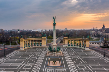 Budapest, Hungary - Aerial view of the totally empty Heroes' Square during the 2020 Coronavirus quarantine in the morning. Vajdahunyad Castle and City Park at background with a warm sunrise
