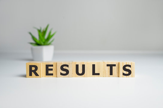 Results - words from wooden blocks with letters, result concept, top view background