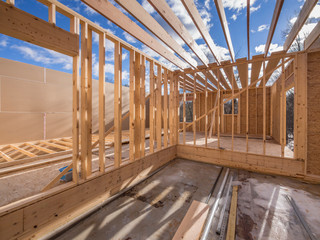 View of interior construction framing of new housing