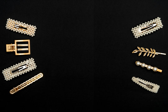Pin set beauty trendy accessories hair pearl clip on black background. Top view. Copy space fot text.