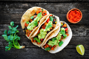 Vegan tacos with black beans, sweet potato and guacamole and tortillas flatbread Wall mural