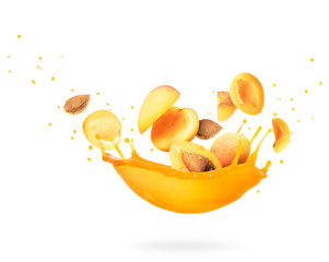 Sliced apricots with splashes of fresh juice isolated on a white background