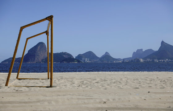 A goalpost is pictured at an empty beach with Rio de Janeiro skyline on the background, during the coronavirus disease (COVID-19) outbreak in Niteroi
