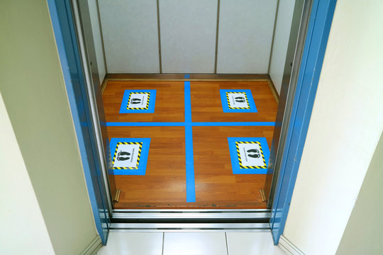 Floor marking of standing position in the elevator for social distancing