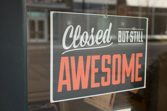 Closed but still awesome sign hanging in business window