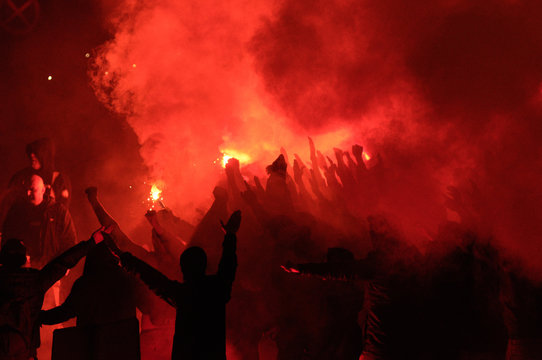 football fans use pyrotechnics after their club win championship.  great bonfire of the yearly celebration