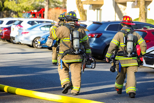 Firefighter at work with protective gear at day