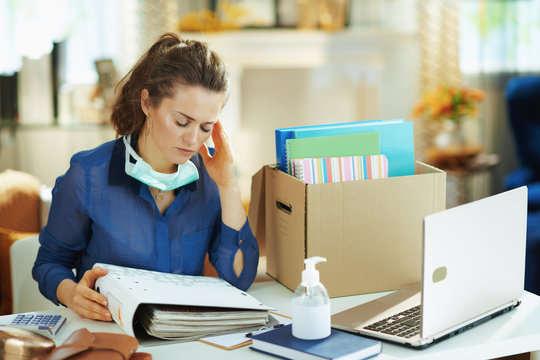 stressed female with mask working in modern house in sunny day