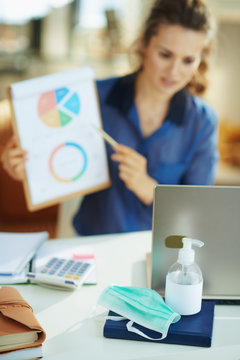 medical mask and hand disinfectant and woman having video chat