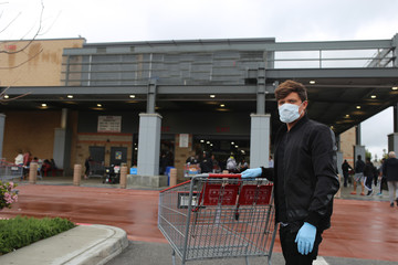 Coronavirus men wearing medical mask and gloves. Covid-19 protection. Pandemic in the USA