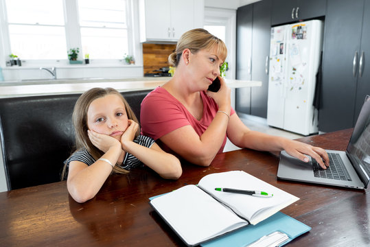 COVID-19 school lockdowns and remote working. Stressed woman working from home with bored daughter