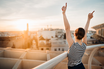 Cheerful happy spanish woman enjoying sunset from a cityscape viewpoint.Tourist having amazing time in Seville,Andalucia,Spain. Opportunities and experience in Andalucia.Enjoying sunshine and panorama Fototapete