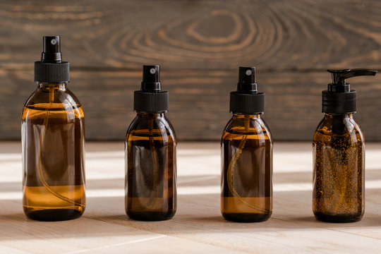 Cosmetic dark amber bottles on wooden  table