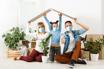 family in protective masks quarantined. Normal life with coronavirus. Lifestyle COVID-19. Quarantine virus protection sterility home together heart symbol