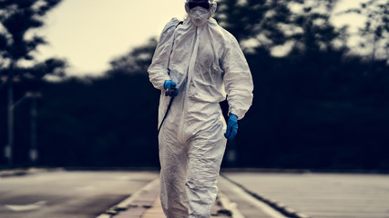 Virology scientists wear PPE kits to clean up viruses.