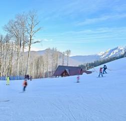 Foto op Aluminium Ontspanning winter sports trails on a snowy mountain landscape