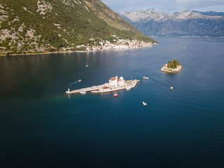 Aerial photo of St. George and monastery on the islands near Perast town in Kotor bay