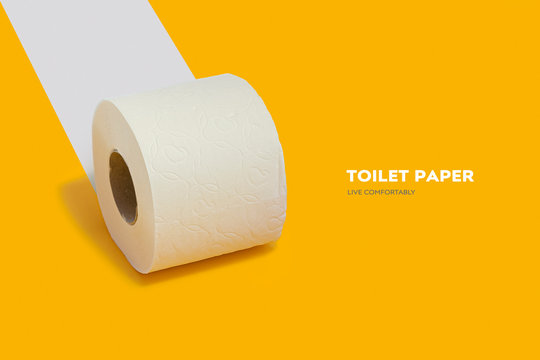 Roll of toilet paper on top on a yellow background for advertising
