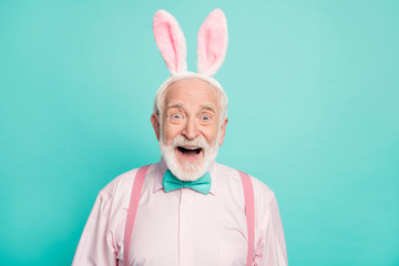 Omg incredible easter tradition promo. Astonished retired old gentleman look wonderful bargains impressed scream wow omg wear pink bunny headband isolated turquoise color background