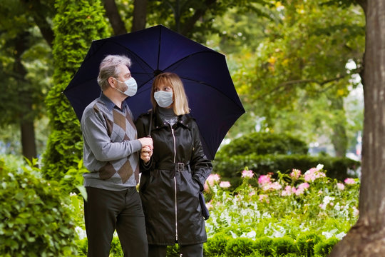 Senior man and woman in face mask. Virus outbreak
