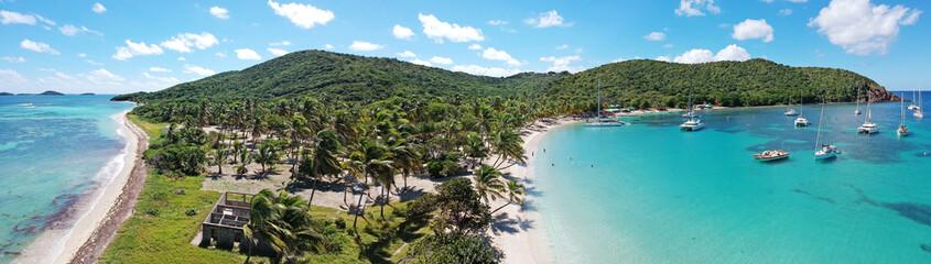 Caribbean Grenadines Mayreau tropical island beach, panoramic aerial view of Salt Whistle Bay
