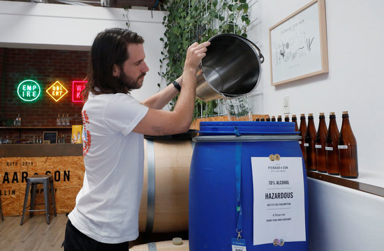 Distiller Andre Pienaar mixes up a batch of  70 percent alcohol, a by-product of the gin making process, which he makes available as hand sanitiser to restrict the outbreak of coronavirus disease (COVID-19) in Cape Town